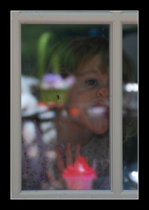 baby licking a window