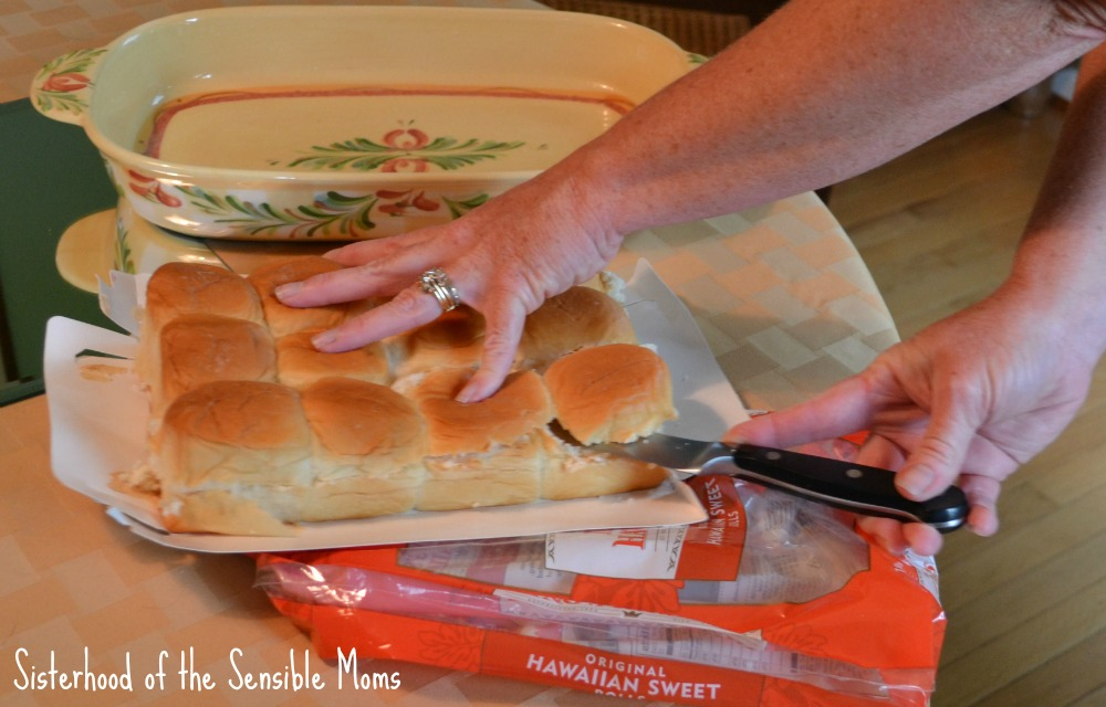 Preparing the rolls for Easy Oven-Baked Cheeseburger Sliders! Tavern goodness without the drive. Perfect for a party OR a busy weeknight! This recipe is the best. | Sisterhood of the Sensible Moms