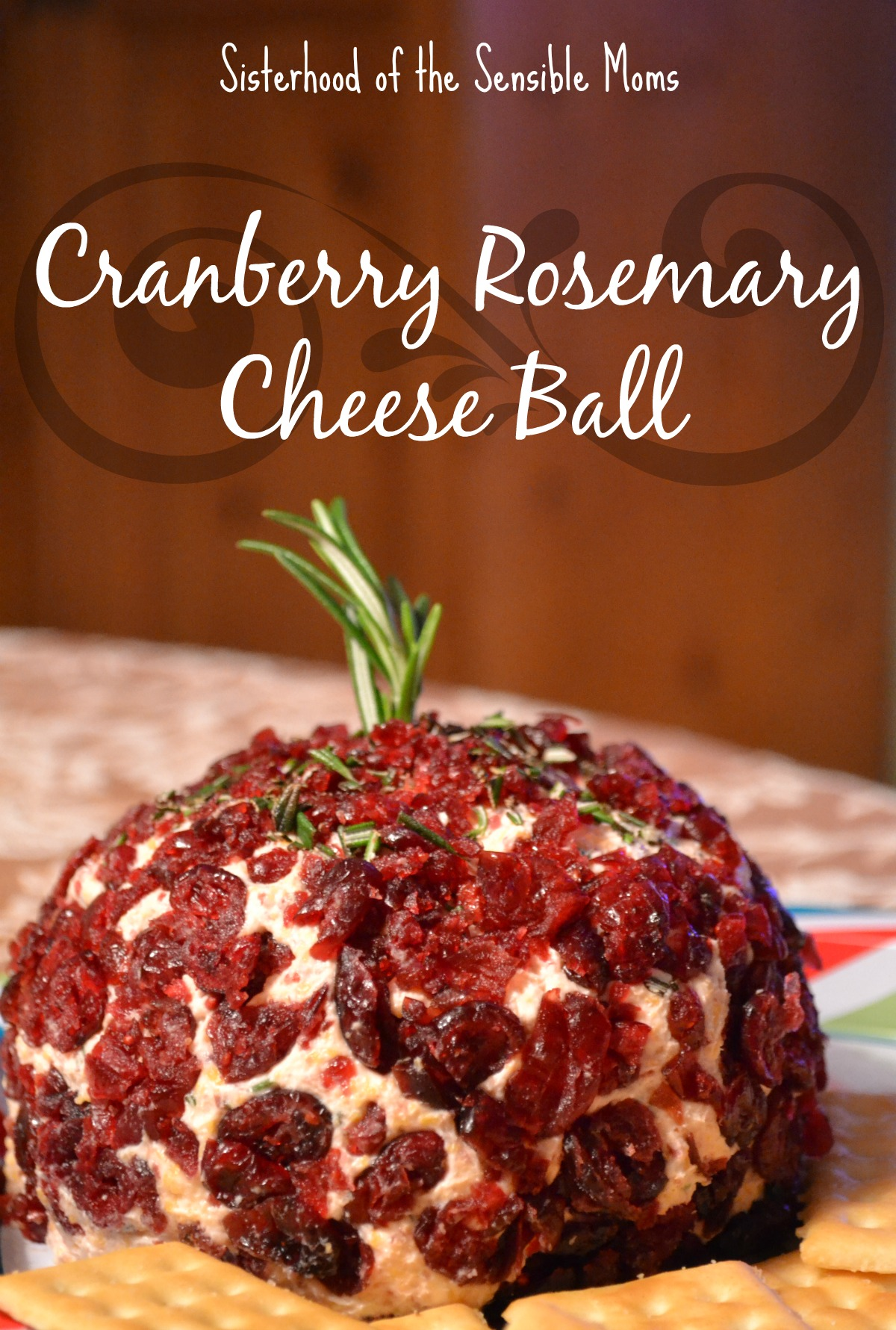 This cranberry rosemary cheese ball recipe is the perfect blend of sweet and savory. Great for a party or tailgate. Sisterhood of the Sensible Moms